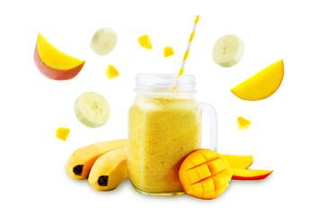 Mango banana smoothie on a white background