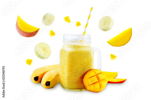 Mango banana smoothie on a white background - 255146793