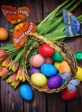Fototapeta Tulipany - Easter background with tulips and painted eggs  © k2photostudio