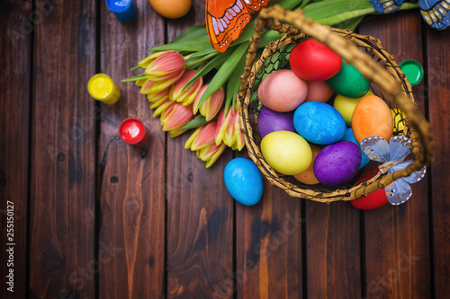 Easter background with tulips and painted eggs
