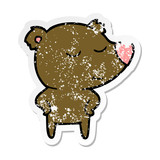 distressed sticker of a happy cartoon bear