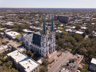 Aerial shot of historic district of Savannah, Georgia with Cathedral of St John in the foreground