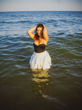 Young simple plus size indian girl in swimwear enjoying vacation, woman with xl figure, pretty girl, vinatge texture