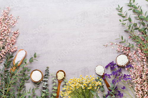 Leinwanddruck Bild Beauty and fashion concept with spa set on pastel rustic wooden background.