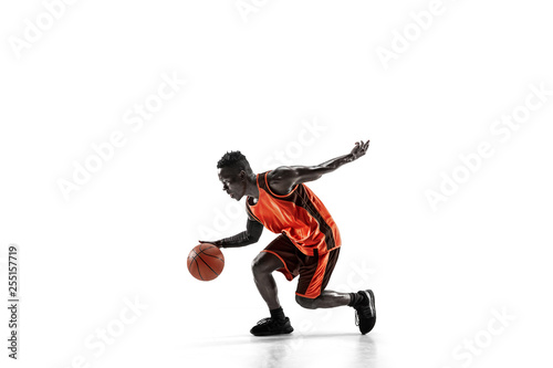 Full length portrait of a basketball player with a ball isolated on white studio background. advertising concept. Fit african anerican athlete with ball. Motion, activity, movement concepts. - 255157719