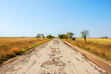 Auto road to the Prairie. Old ruined road to the steppe.