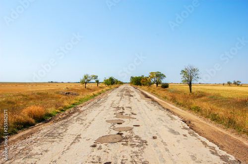 Auto road to the Prairie. Old ruined road to the steppe. © Valery