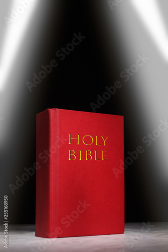 holy bible book rest on a marble table with copy space for your text © Andrea