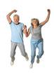 Leinwanddruck Bild - Portrait of senior couple jumping on a white background