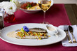 baked sea bass with vegetables and sauce - 255176953