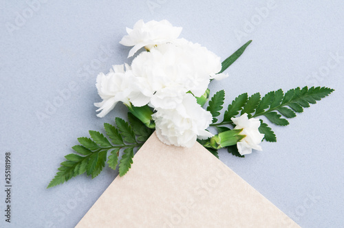 white carnation flower arrangment on a blue background