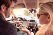 Leinwanddruck Bild - Back view of couple in car