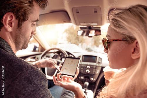 Leinwanddruck Bild Back view of couple in car