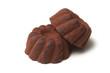 Closeup of chocolate truffles in shaped Kougelhopf on white background
