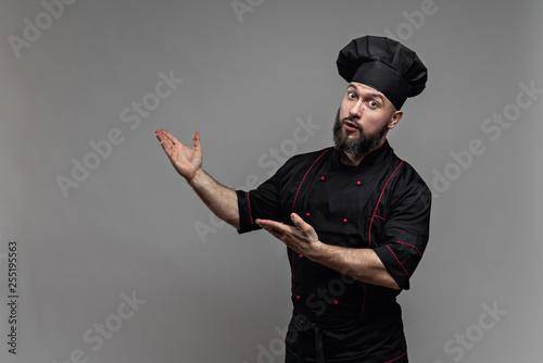 Leinwandbild Motiv chef in black jacket with beard