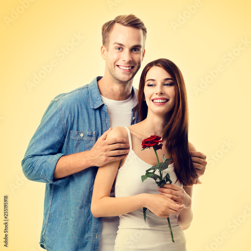 Hugging couple with rose