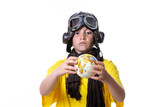 Young boy with yellow T-shirt, aviator goggles, plane and world ball smiling