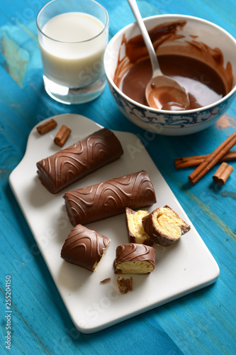 delicious chocolate, milk and cinnamon sweets with ingredients around