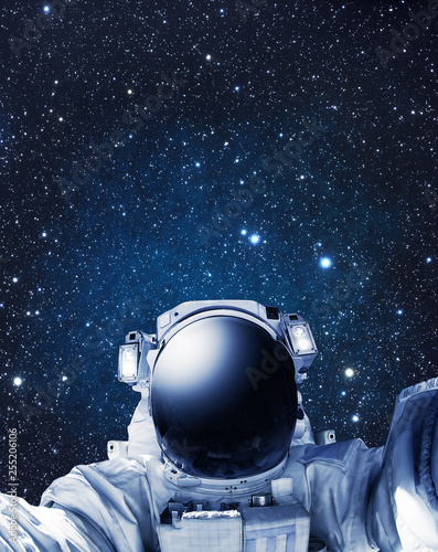 Astronaut in outer space, stars in the background - Some elements of this image furnished by NASA - 255206106