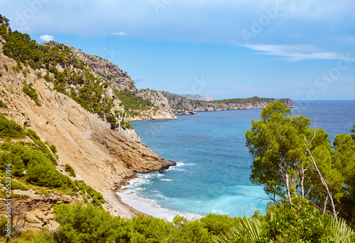 Scenic mountainous landscape with Coll Baix beach on Mallorca, Spain.
