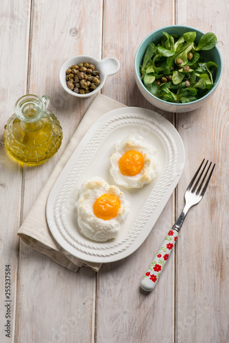 owen eggs eith salad capers and olive oil