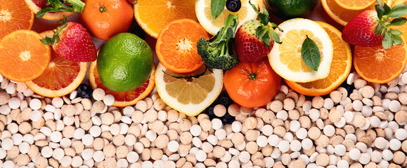 Vitamins in fruits and vegetables and vitamin pills © bit24