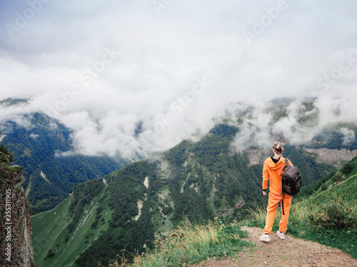Man at the top of the mountains - 255311905