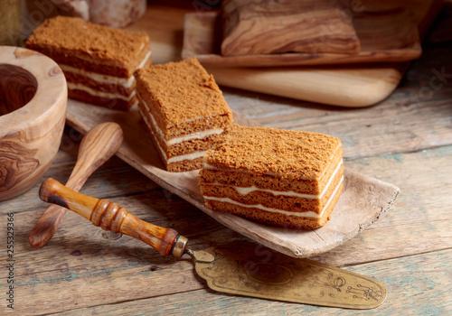Layered honey cake with cream.