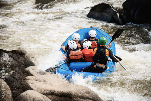 People playing raft adventure sport activity in the river