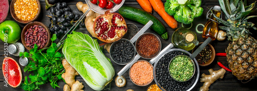 Organic food. Variety of healthy fruits and vegetables with legumes .
