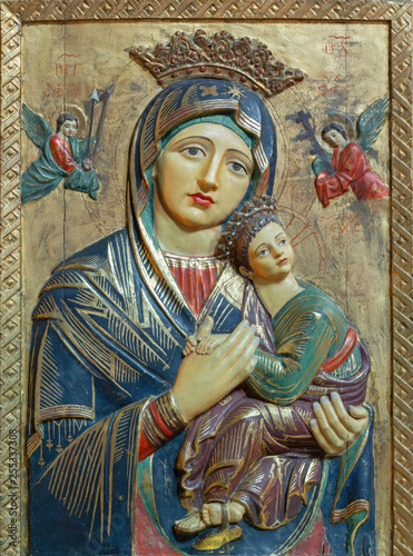 PALMA DE MALLORCA, SPAIN - JANUARY 26, 2019: The carved polychrome relief of Madonna (Our Lady of Perpetual Help) in church Iglesia de Santa Margarita by unknown artist. © Renáta Sedmáková