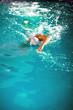 Leinwanddruck Bild - young athlete swimmer recreating on outdoor