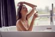 Leinwanddruck Bild - relaxing female in bath with foam and drink champagne.