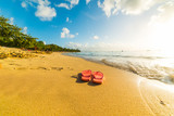 Flip flops on the sand in Le Souffleur beach in Guadeloupe