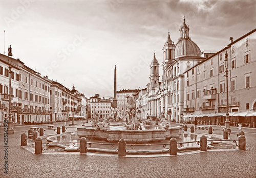 obraz PCV ROME, ITALY - MARCH 12, 2016: Piazza Navona in morning and Fountain of Neptune (1574) created by Giacomo della Porta and Santa Agnese in Agone church