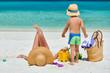 Woman with three year old boy on beach