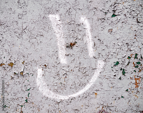 Painted smile sign on concrete wall - 255385950