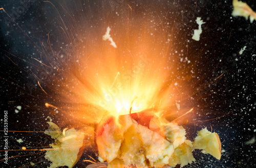 Apple burst into pieces on black background © Vasily Popov