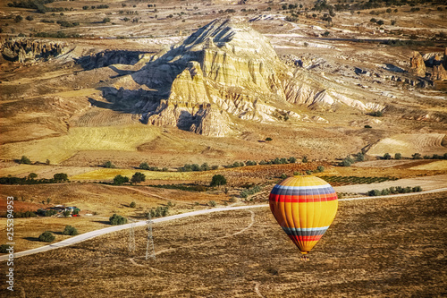Flight in the balloon in the mountains of Cappadocia early in the morning. Turkey.