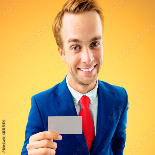 Businessman showing business or plastic card, with copyspace