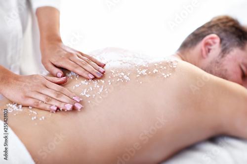 Leinwanddruck Bild Handsome man having massage in spa salon