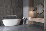 Concrete bathroom corner, tub and sink
