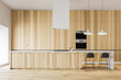 Leinwanddruck Bild - Minimalistic wooden kitchen with bar and ovens