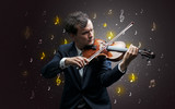 Young violinist with falling musical notes wallpaper and classical concept
