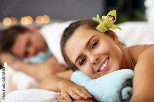 Leinwanddruck Bild Adult happy couple relaxing in spa salon