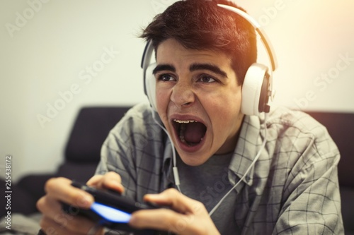 young euphoric playing video games