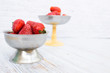 Bright ripe strawberry in a metal cups on a light background. - 255443707