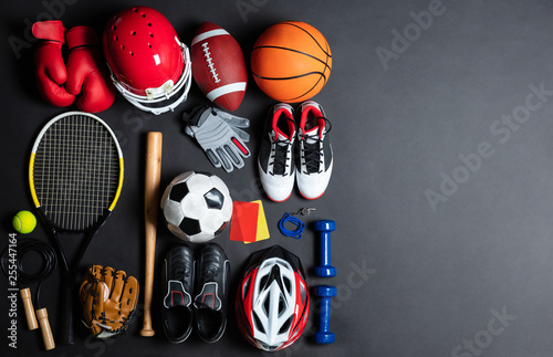 Sport Equipment On Black Background - 255447164