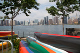 NYC skyline from Long Island City with colorful canoes and the East River