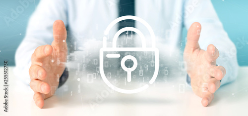 Businessman holding a Binary cloud with internet security padlock 3d rendering
